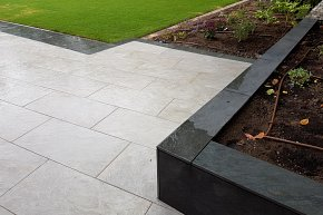 Patio, raised beds, planting pockets, steps, porcelain paving