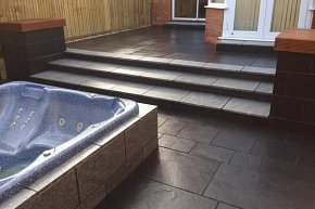 Black limestone and silver granite patio