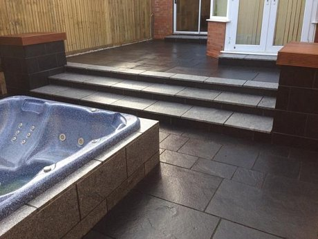 Black limestone paving with silver grey granite steps