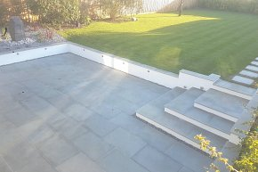 lawn and sawn grey sandstone patio completed view 1