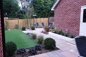 Sandstone paving, terrace, patio and artificial lawn