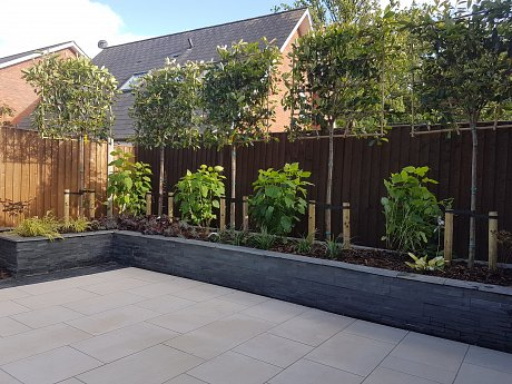 Marshalls symphony vitrified paving in barley with Fairstone Slate and Stoneface