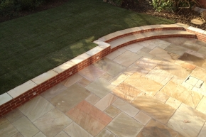 Sandstone patio with new retaining wall and steps